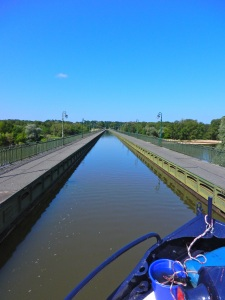 The pint canal at Briare is a 682 meter (almost a half-mile) tub, designed in part by the ubiquitous Gustave Eiffel, on which we motored over the Loire River.