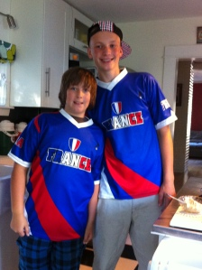 Abram and Noah in their new France football (a.k.a. soccer) shirts. They are deep into football at home (a.k.a. football).