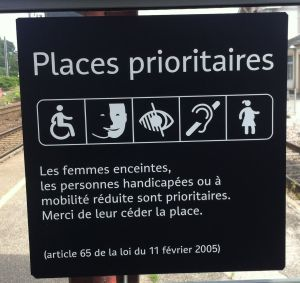 The mysteries of French signage continued. This sign at an Alsatian train station, described reserved sitting places for people with disabilities. We figured out the handicapped person, the blind person, the deaf person and the pregnant person. But thge second symbol from the left puzzled us. Could they really be reserving a bench for multiracial people?