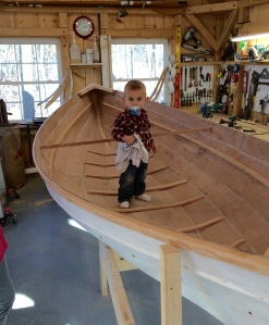 Mini Viking. The winter was spent building a peapod , a traditional Maine rowing boat with Viking genes. Our grandson Ellis has the traditional Viking gear of binkie and blankie.